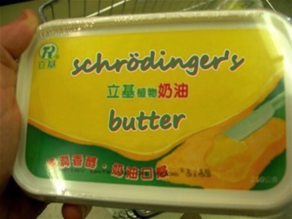 Is there Cat eating the Butter in that box